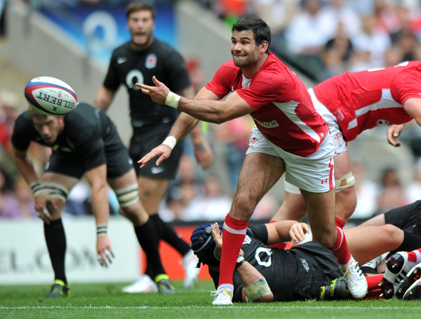 Mike Phillips of Wales passes the ball